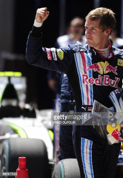 Red Bull's German driver Sebastian Vettel celebrates in the parc ferme of the Istanbul Park circuit on June 6, 2009 in Istanbul, after the qualifying...
