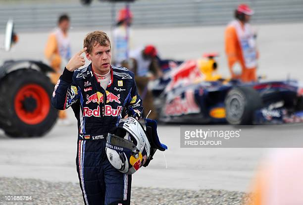 Red Bull's German driver Sebastian Vettel gestures as he leaves the Istanbul Park circuit after he crashed on May 30 during the Turkish Formula One...