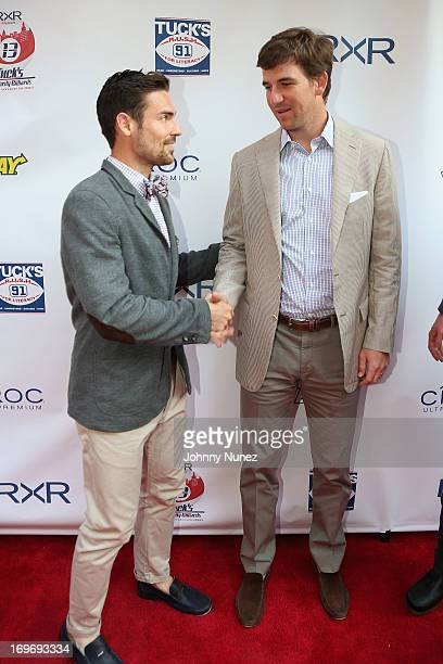 Red Bulls Heath Pearce and NY Giants Eli Manning attend the NY Giants Justin Tuck's 5th Annual Celebrity Billiards Tournament on May 30, 2013 in New...