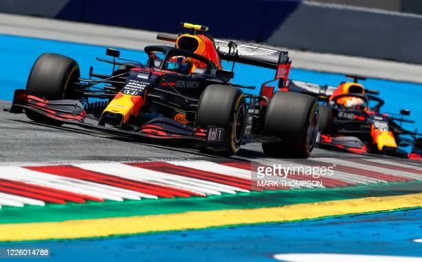 Red Bull's Thai driver Alex Albon is followed by teammate Dutch driver Max Verstappen during the first practice session for the Formula One Styrian...