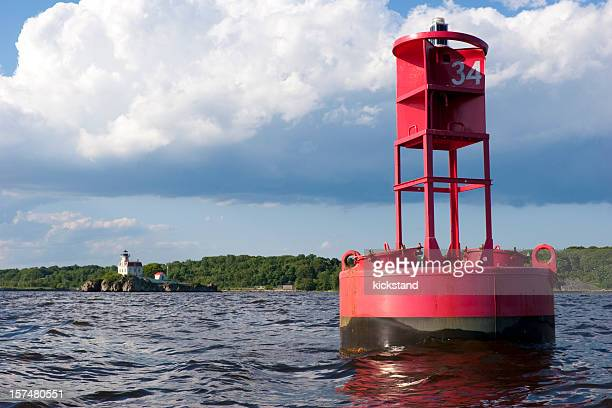 Red buoy and white lighthouse in Rhode Island