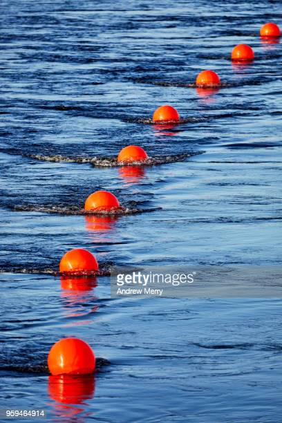 Red buoy line, floating barrier in river