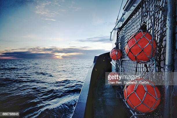 red buoy on tugboat in sea against sky at dusk - tugboat stock photos and pictures