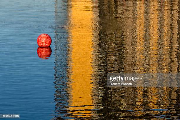 Red buoy & reflections in lagoon