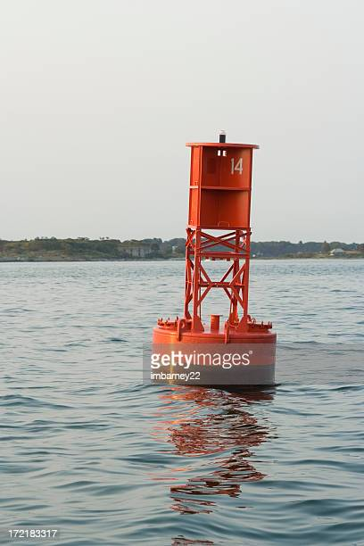red buoye - buoy stock photos and pictures