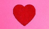 red burlap heart pink background