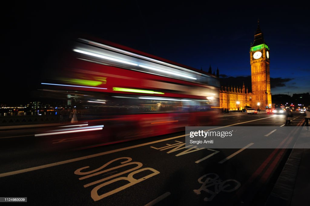 Red bus light trails by Big Ben : Stock Photo