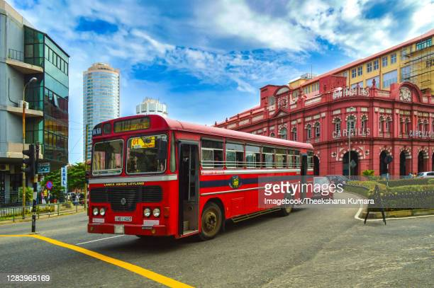 red bus, old and new buildings at fort, colombo. - imagebook stock pictures, royalty-free photos & images