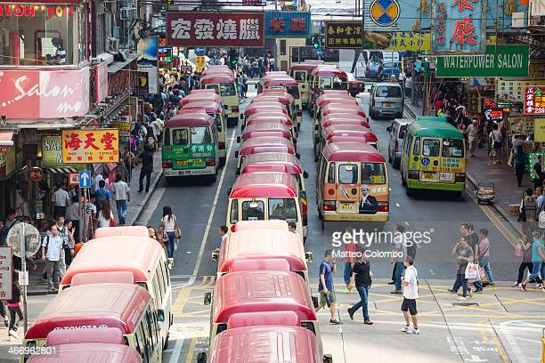 Red buses lined up in a street in Mong Kok quarter, elevated view. Hong Kong, China