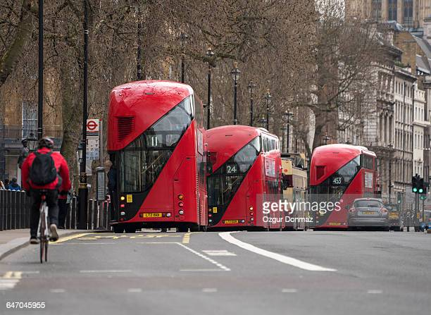 Red busses seen from Whitehall, London
