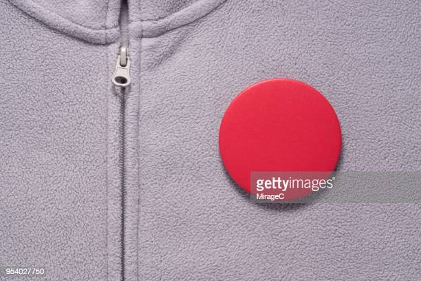 red button badge on gray cloth - campaign button stock pictures, royalty-free photos & images