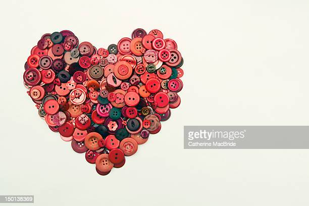 red button heart - catherine macbride stock pictures, royalty-free photos & images