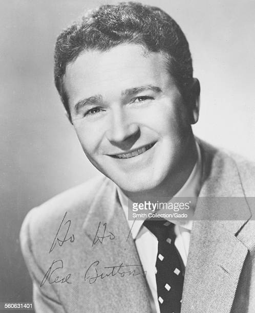 Red Buttons comedian and actor wearing a suit and smiling 1954