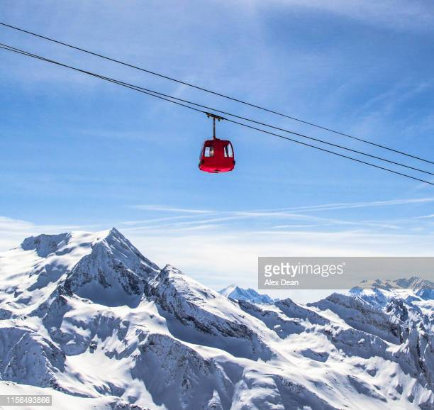 red cable car. - overhead cable car stock pictures, royalty-free photos & images
