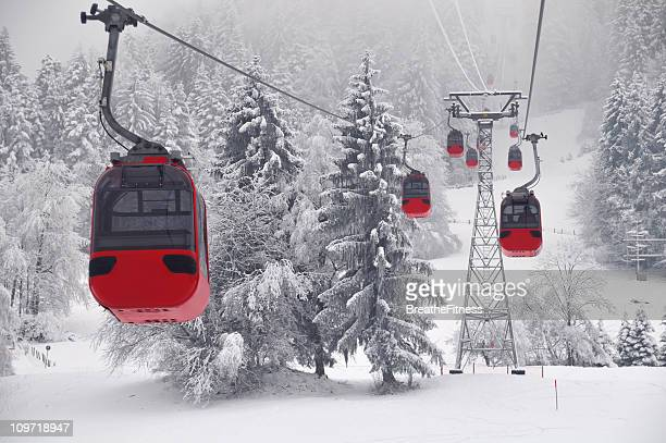 red cable cars - ski lift stock pictures, royalty-free photos & images