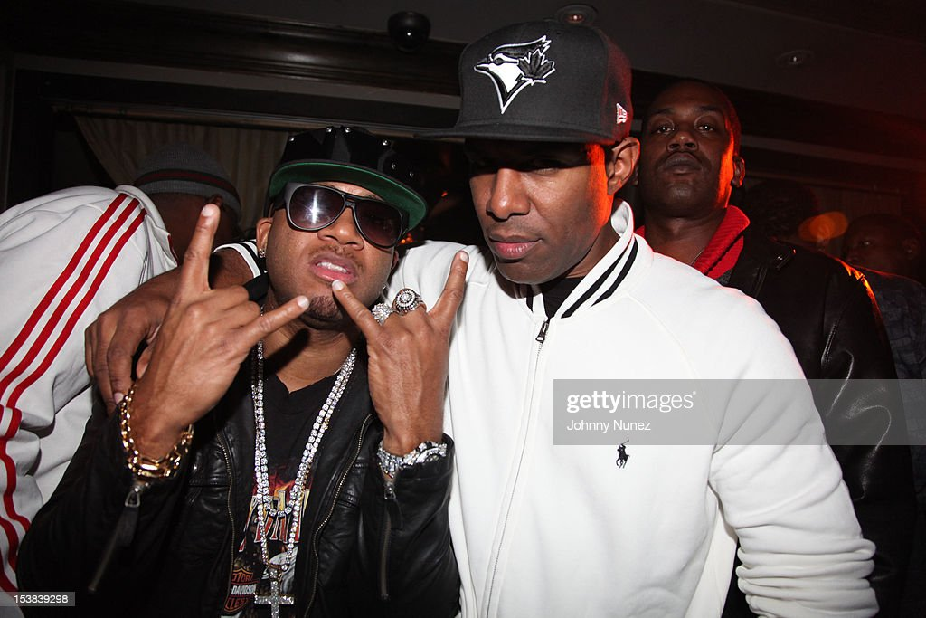 Red Cafe and DJ Whoo Kid attend Machine Gun Kelly's Album Release Party at RDV on October 8, 2012 in New York City.