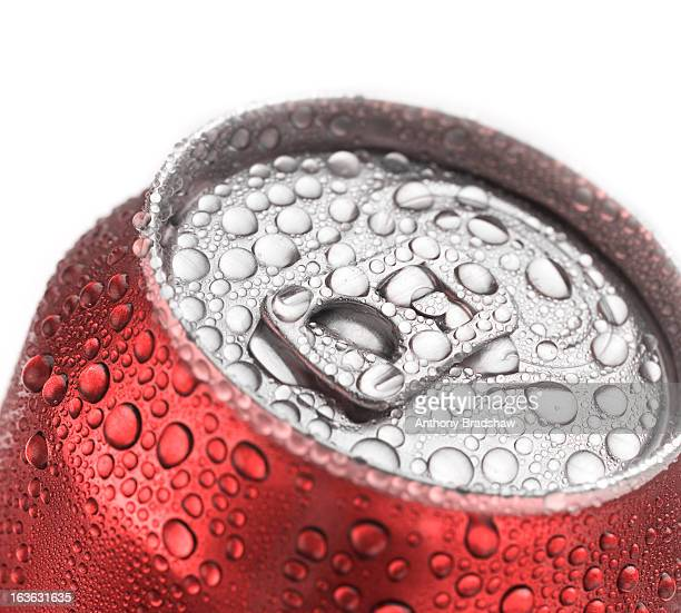 Red can of drink covered in heavy condensation
