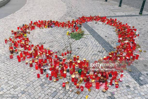 red candles laid in heart shape - memorial event stock pictures, royalty-free photos & images