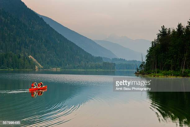 Red canoe on Alpine lake, Canada