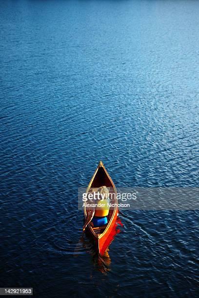 Red Canoe on lake