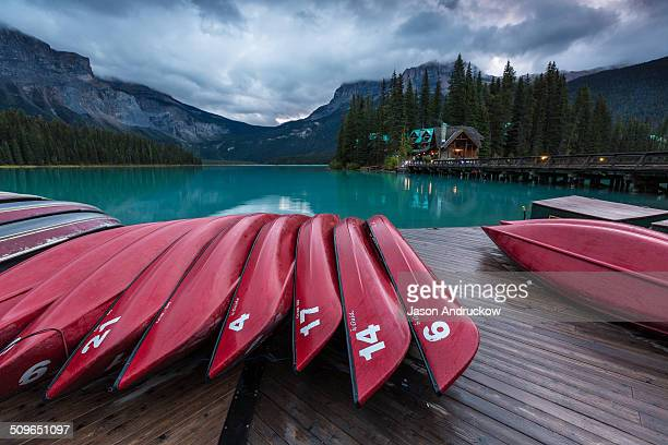 Red canoes on the dock of Emerald Lake in Yoho National Park British Columbia