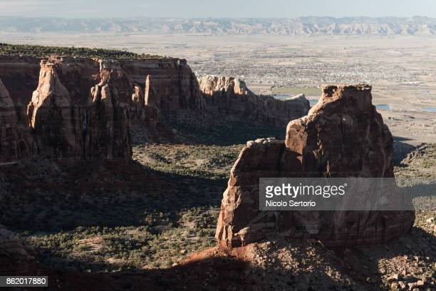 Red canyon with city in background