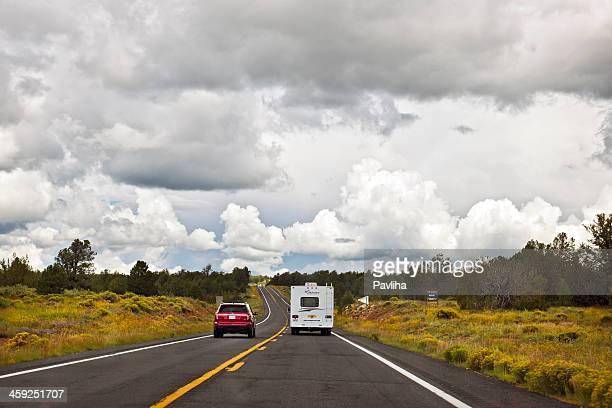 Red Car and RV Driving towards Grand Canyon Arizona USA