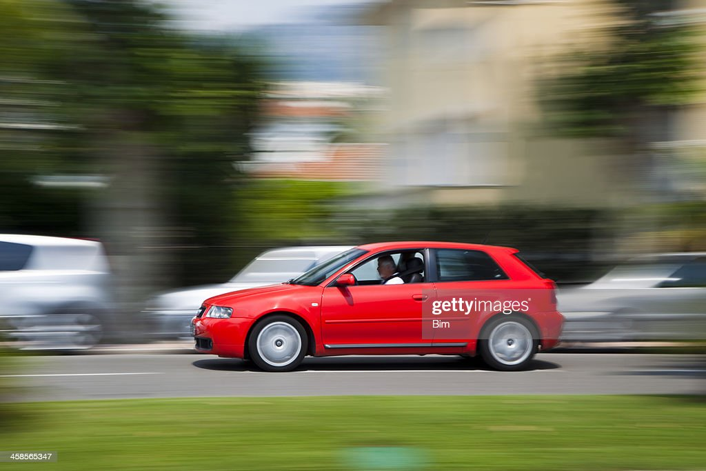 Red Car Audi A3  driving along promenade in Menton, France : Stock Photo