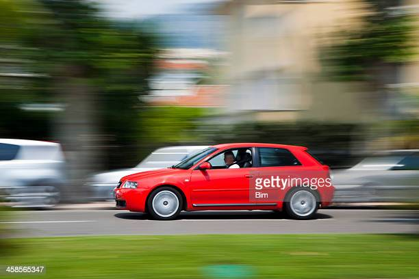 Red Car Audi A3  driving along promenade in Menton, France