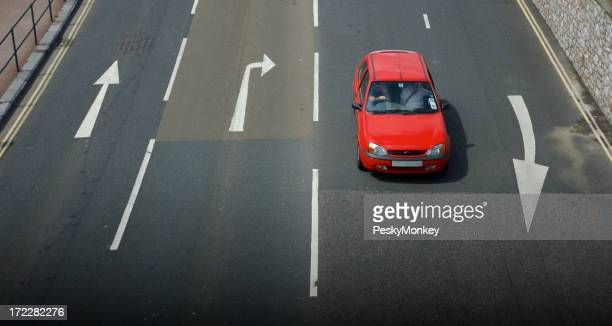 Red Car Driving on Road with Arrows from Above