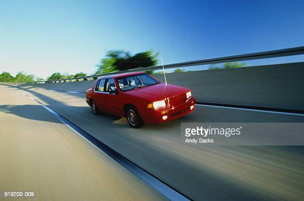 red car on test track - test track stock pictures, royalty-free photos & images