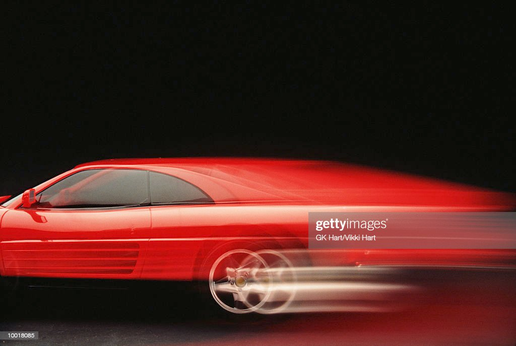 Red car (blurred motion) : Stock Photo