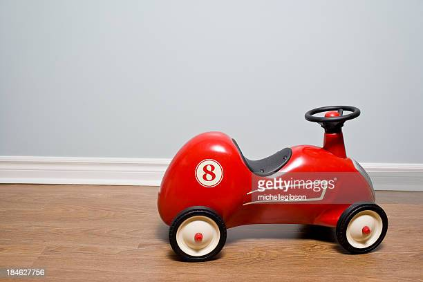 Red Car vintage toy car on a hardwood floor