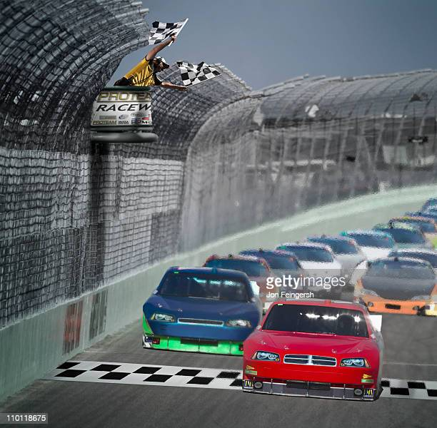 Red car wins the race as checkered flags wave.