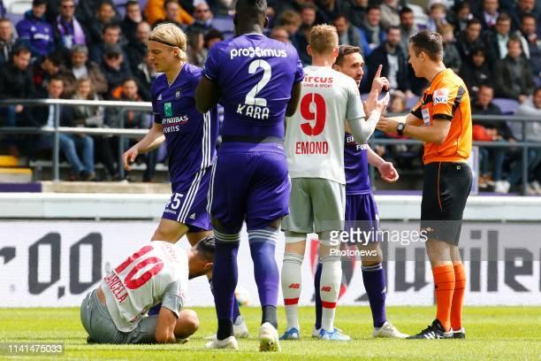 red card forSebastiaan Bornauw defender of Anderlecht and referee Bram Van Driessche and Medhi Carcela midfielder of Standard Liege pictured during...