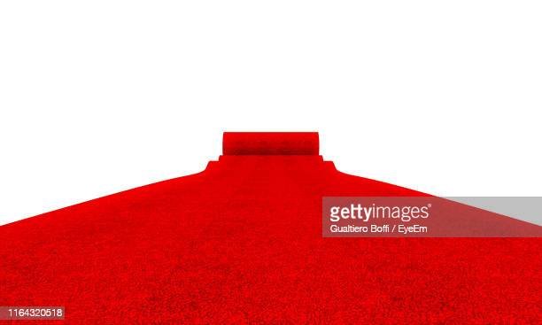 red carpet against white background - red carpet event stock pictures, royalty-free photos & images