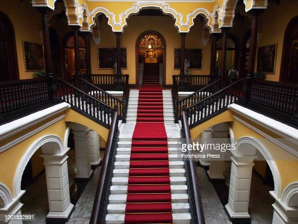 Red carpet and marble staircase in the main hall of the Archbishop's Palace of Lima.