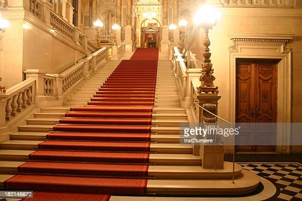 red carpet cascading down a grand staircase - red carpet event stock pictures, royalty-free photos & images