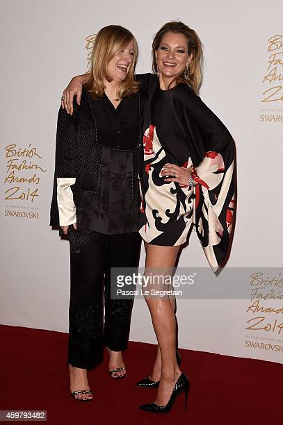 Red Carpet Designer for Alexander McQueen Sarah Burton and Kate Moss pose in the winners room at the British Fashion Awards at London Coliseum on...