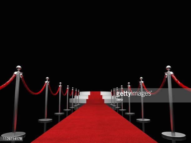 red carpet event amidst bollards against black background - red carpet event photos et images de collection