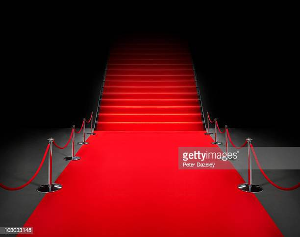 red carpet event with poles and rope - red carpet event photos et images de collection
