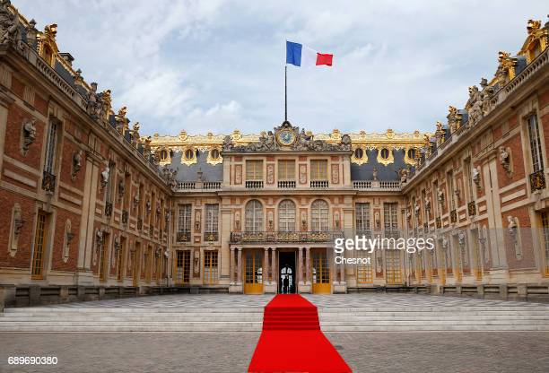 Red carpet has been set in the courtyard of the Versailles Palace ahead of the arrival of Russian President Vladimir Putin for a meeting with French...