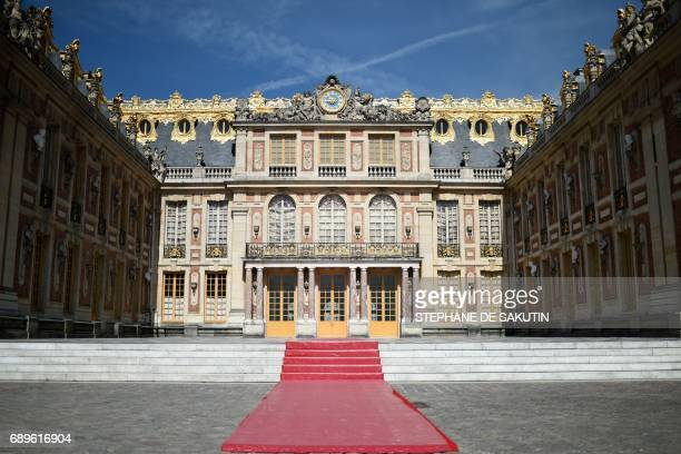 Red carpet has been set in the courtyard of the Versailles Palace on May 29, 2017 near Paris, ahead of the arrival of Russia's president for a...