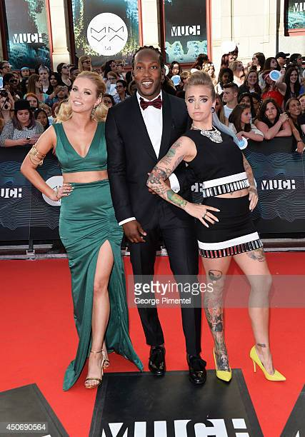 MMVA red carpet hosts Liz Trinnear Tyrone Edwards and Phoebe Dykstra arrive at the 2014 MuchMusic Video Awards at MuchMusic HQ on June 15 2014 in...