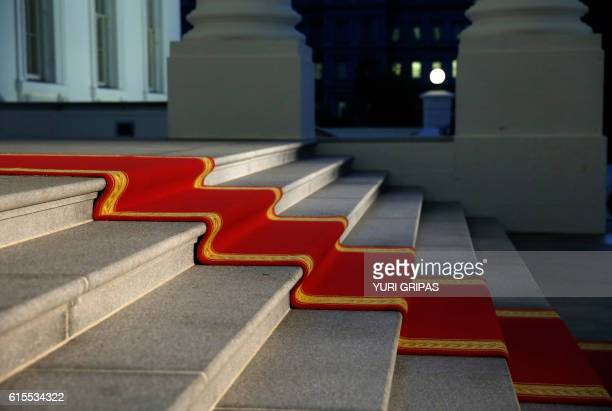 A red carpet is prepared before US President Barack Obama welcomes Italian Prime Minister Matteo Renzi on the North Portico of the White House before...