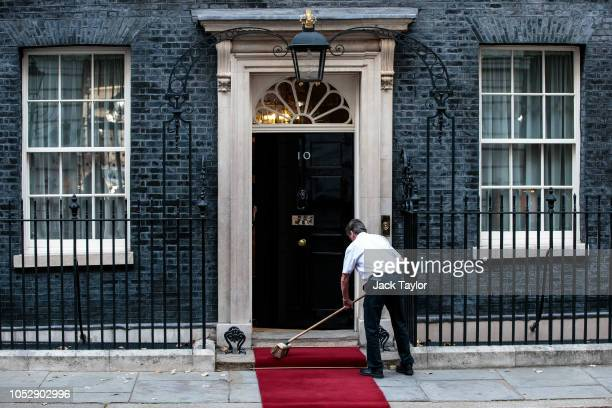 A red carpet is swept ahead of the arrival of King WillemAlexander and Queen Maxima of the Netherlands outside Number 10 Downing Street on October 24...