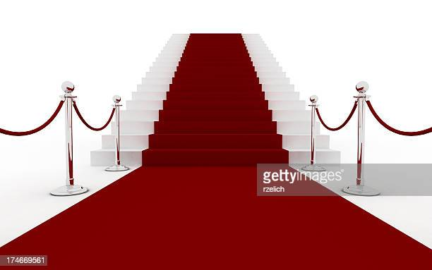 Red carpet leading to white stairs