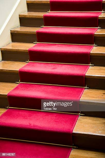A red carpet on a staircase