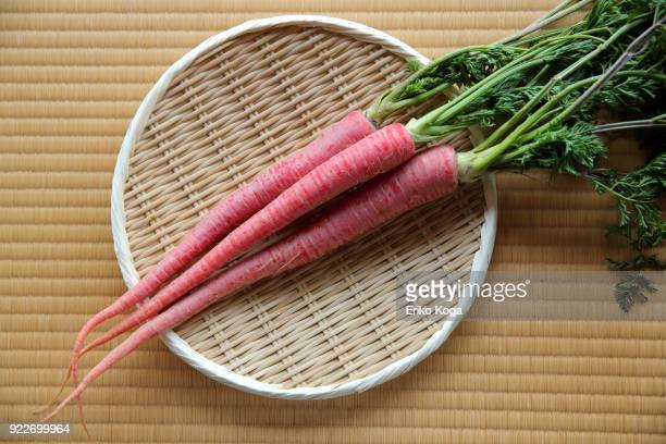Red carrots of Kyoto putting on woven bamboo tray