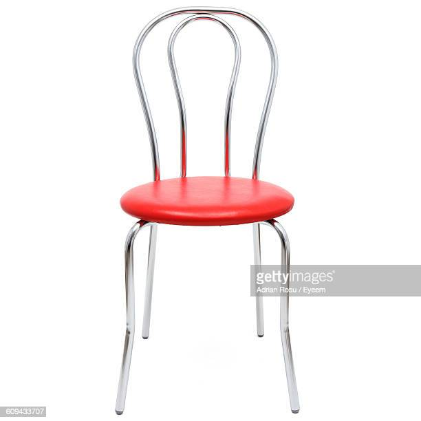 Red Chair Against White Background